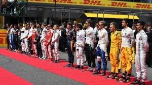 Drivers observe the Natioanal Anthem on the grid at Formula One World Championship, Rd3, Chinese Grand Prix, Race, Shanghai, China, Sunday 17 April 2016. © Sutton Motorsport Images
