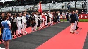 Drivers line the grid for the national Anthem at Formula One World Championship, Rd9, Austrian Grand Prix, Race, Spielberg, Austria, Sunday 3 July 2016. © Sutton Images