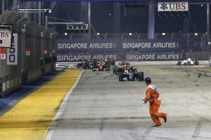 A marshal appearing on the main straight at Formula One World Championship, Rd15, Singapore Grand Prix, Race, Marina Bay Street Circuit, Singapore, Sunday 18 September 2016. © Sutton Images
