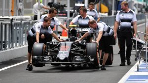 McLaren mechanics with McLaren MP4-31 in pit lane at Formula One World Championship, Rd16, Malaysian Grand Prix, Preparations, Sepang, Malaysia, Thursday 29 September 2016. © Sutton Images