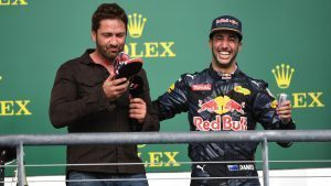 Daniel Ricciardo (AUS) Red Bull Racing offers Gerard Butler (GBR) Actor a drink from his shoe on the podium at Formula One World Championship, Rd18, United States Grand Prix, Race, Circuit of the Americas, Austin, Texas, USA, Sunday 23 October 2016. © Sutton Images