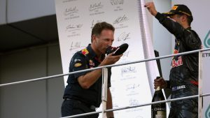 Christian Horner (GBR) Red Bull Racing Team Principal and race winner Daniel Ricciardo (AUS) Red Bull Racing celebrate on the podium and drink champagne from a shoe at Formula One World Championship, Rd16, Malaysian Grand Prix, Race, Sepang, Malaysia, Sunday 2 October 2016. © Sutton Images