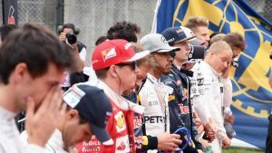 Drivers observe the National Anthem on the grid at Formula One World Championship, Rd17, Japanese Grand Prix, Race, Suzuka, Japan, Sunday 9 October 2016. © Sutton Images