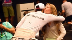 Vivian Rosberg (GER) wife of Nico Rosberg (GER) Mercedes AMG F1 is congratulated by Lewis Hamilton (GBR) Mercedes AMG F1 at the Press Conference at Formula One World Championship, Rd21, Abu Dhabi Grand Prix, Race, Yas Marina Circuit, Abu Dhabi, UAE, Sunday 27 November 2016. © Sutton Images